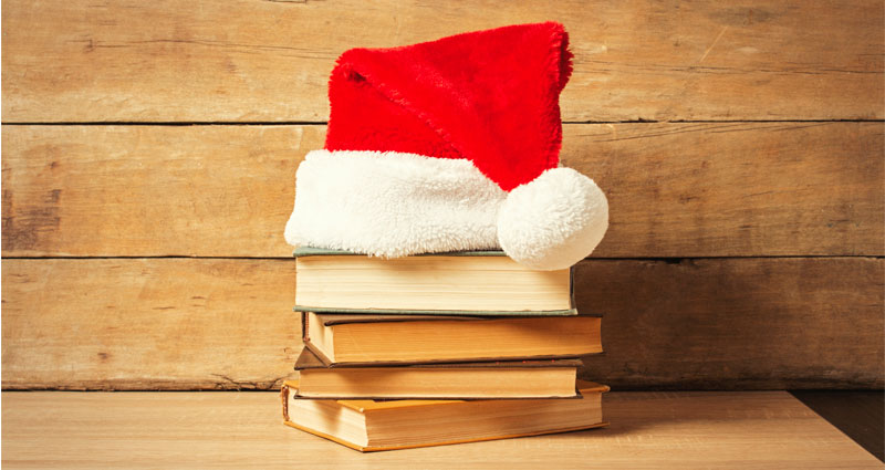Santa hat on book pile