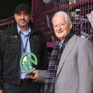 Hornsby Shire Council's Mayor, Philip Ruddock, and Benn Judkins (Operations Co-ordinator for Waste and Cleansing  - wearing cap) with MobileMuster 2021 trophy.