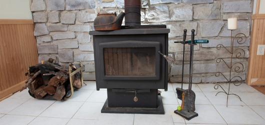 wood burner heater against wall