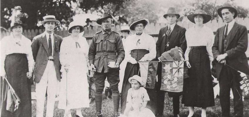 Photograph of a family welcoming home their Australian war hero son and brother in 1919