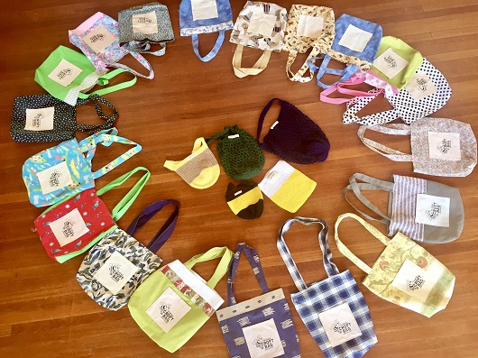 Photograph of handmade bags on floor