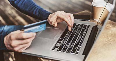 paying online on laptop