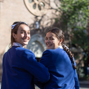 Two school girls in front of school