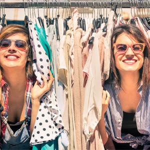 two women in in clothing rack