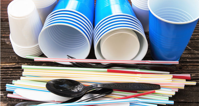 plastic cups, straws and cutlery