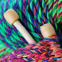 Detail from a photograph of knitting needles and knitting wool