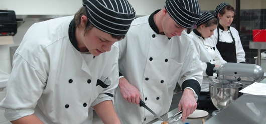 Staff working in a commercial kitchen