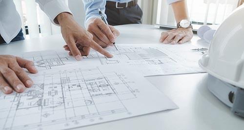 examining design plans