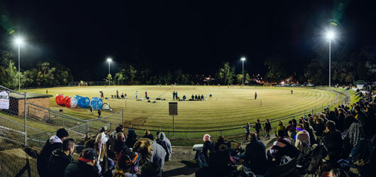 sportsground under lights at night
