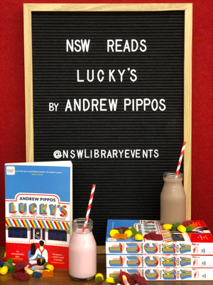 Blackboard with milkshakes and books