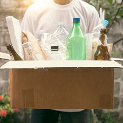 man with recycling in cardboard box