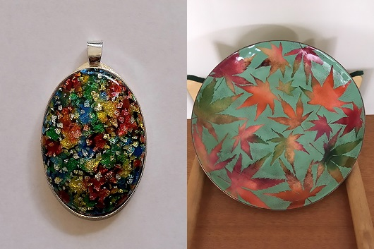 Photographs of a pendant by Jimmy Lim and a plate by Annette Clark