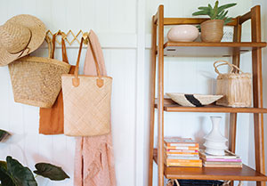 baskets hanging on wall beside storage shelves